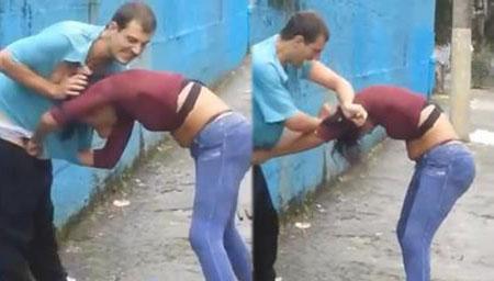 实拍男子与站街女起争执 遭数名女子当街围殴