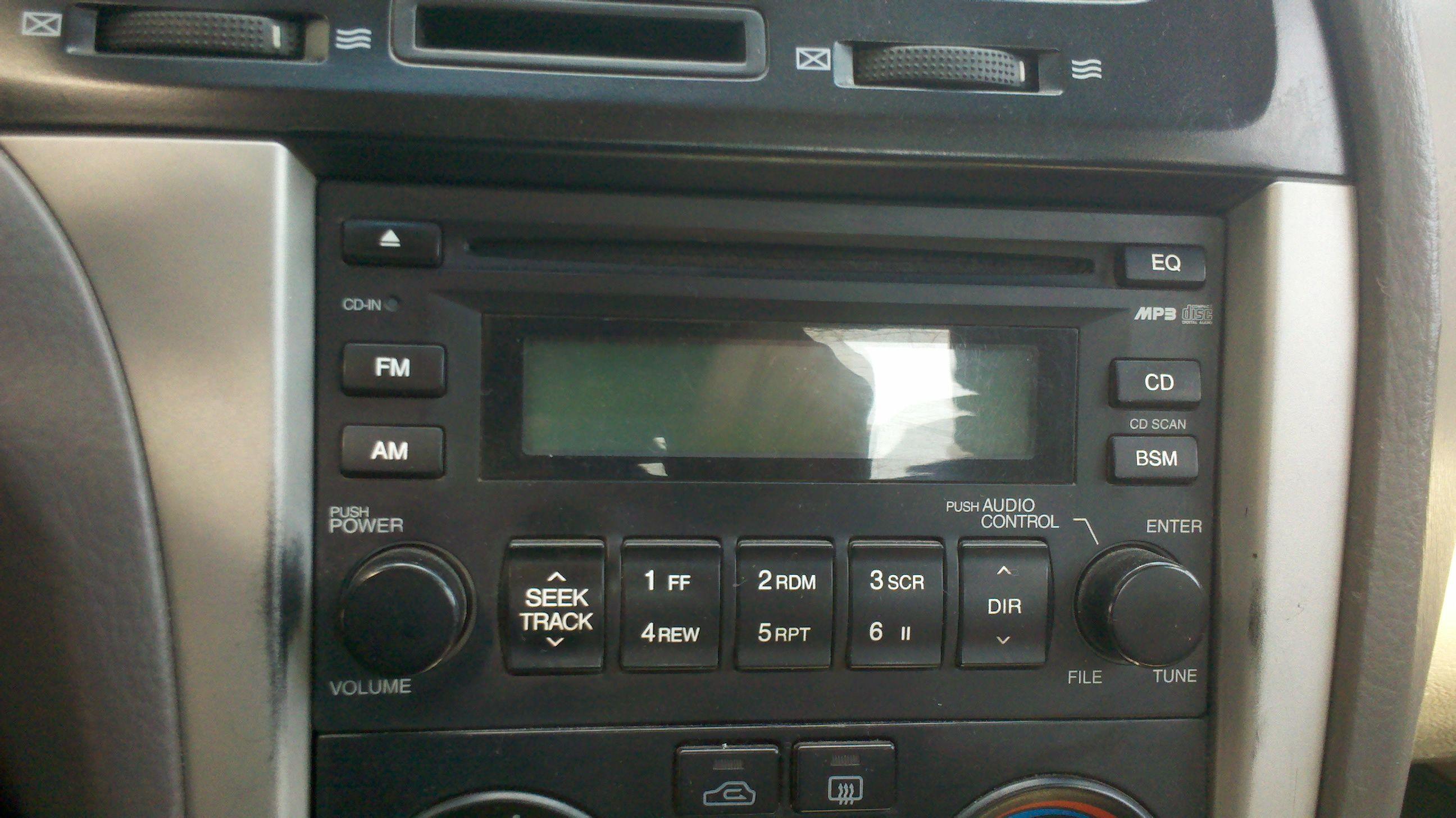 07年款的现代伊兰特汽车上的cd机怎么拆卸下来 高清图片