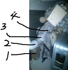 海尔洗衣机不存水.应该是硬币卡在排水阀了.图片